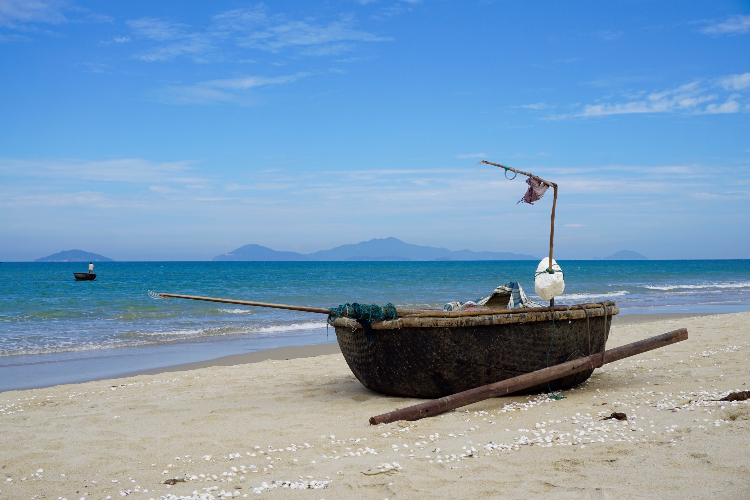 a local fishing boat and the South China Sea